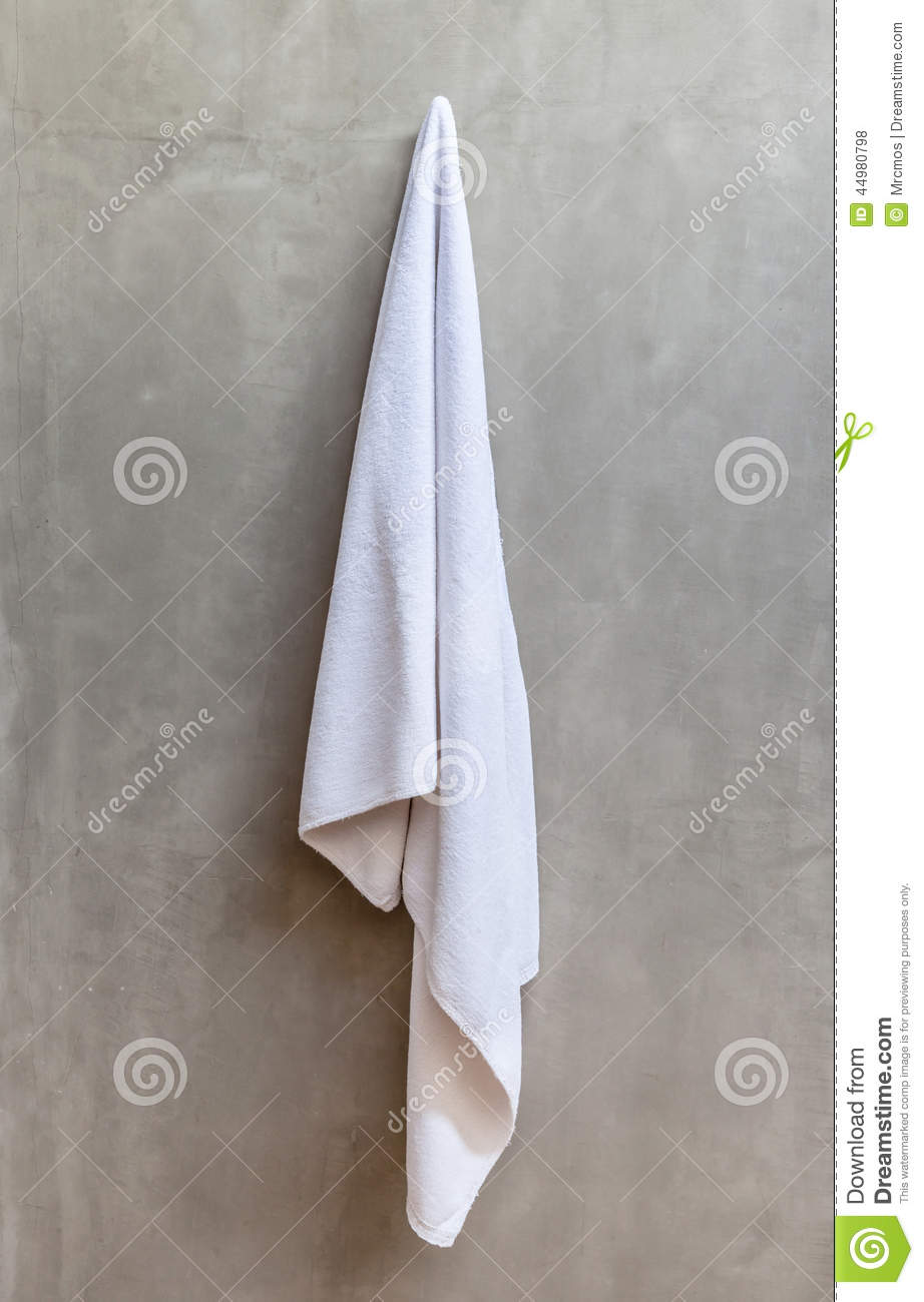 Hanging White Towel Draped On Exposed Concrete Wall In The Bathr Stock Photo  Image 44980798