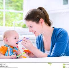Baby High Chair For Eating Mongolian Fur Happy Aby Boy His First Solid Food Witn Mother Stock Photo - Image: 41770393