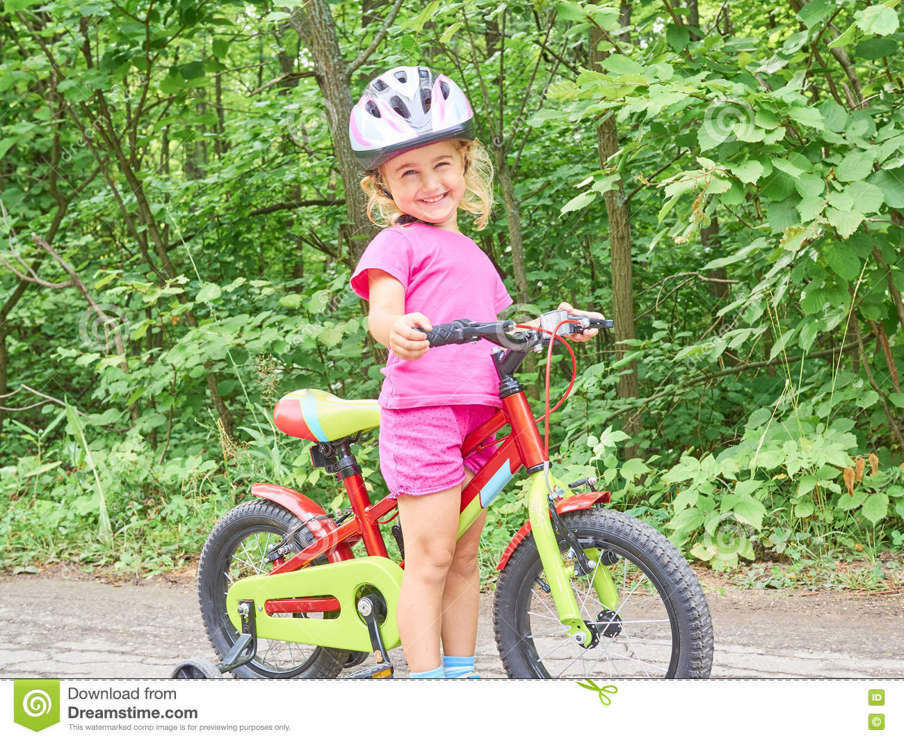 Happy Child Riding A Bike In Outdoor Stock Image