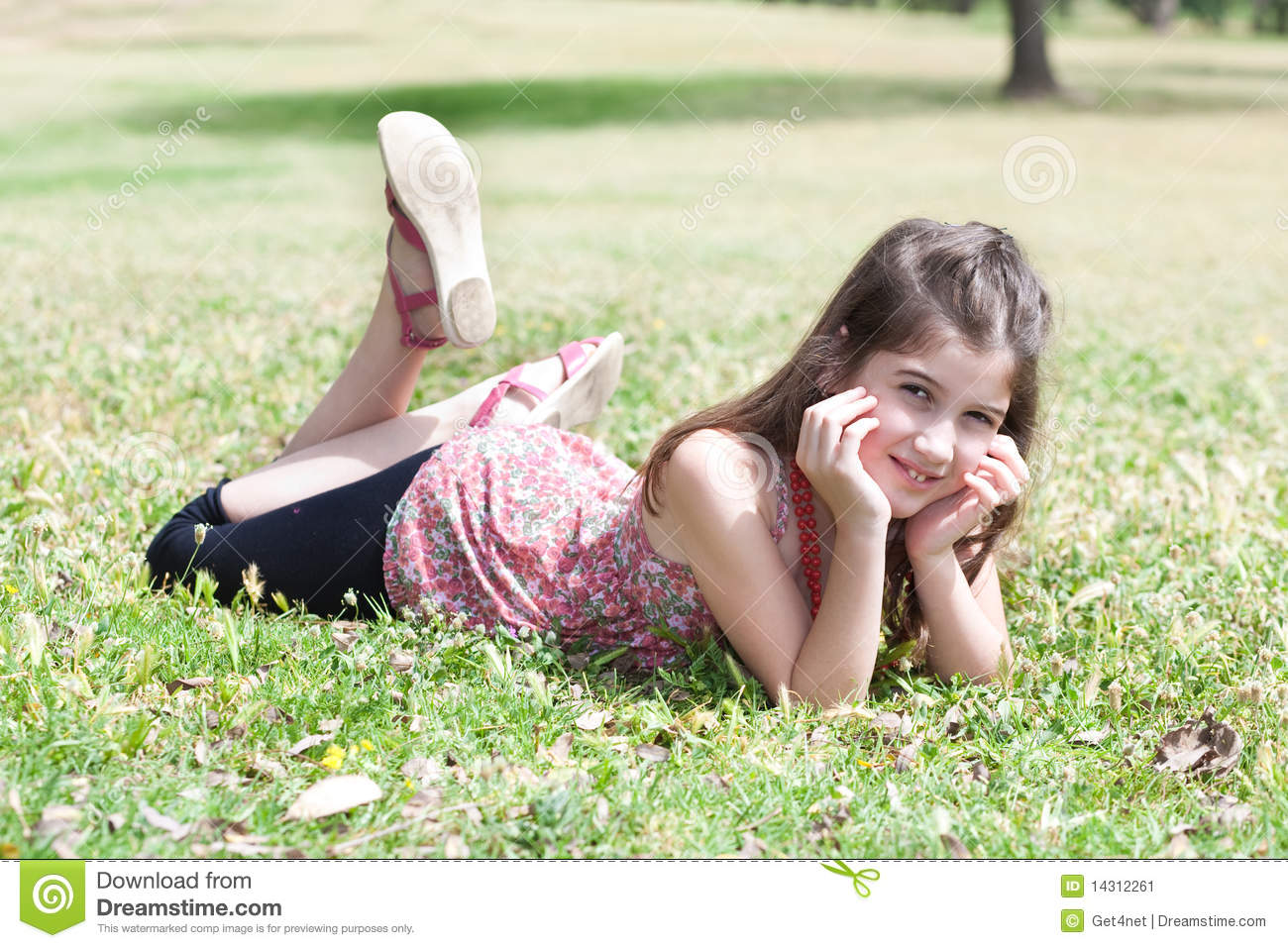 Happy Cute Girl Laying On A Grass Field Stock Image ...