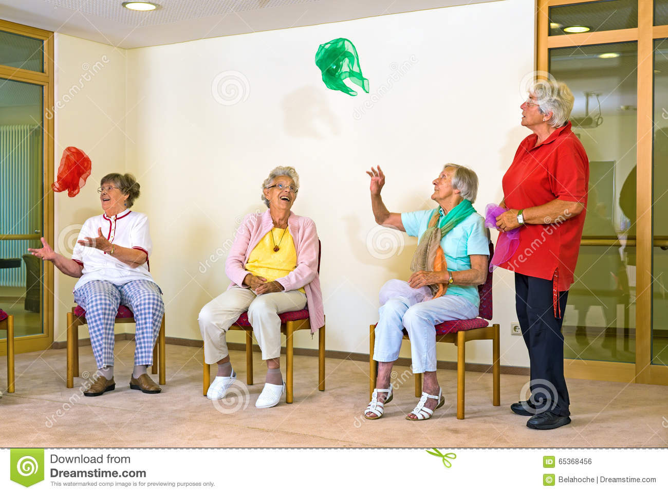 chair games for seniors comfy room chairs happy elderly ladies in a gym stock photo image 65368456
