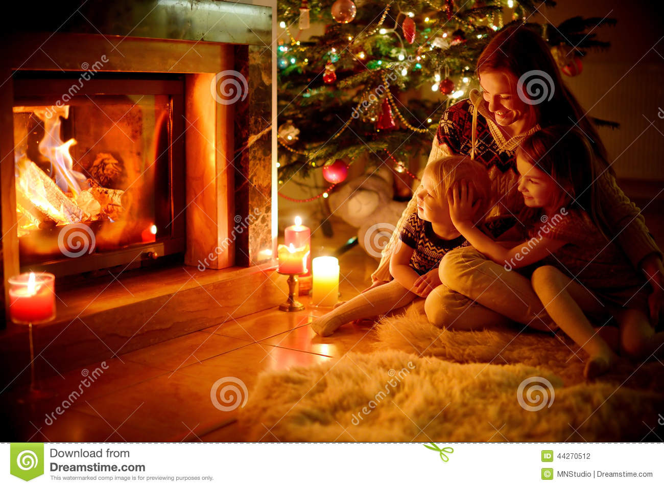 Free Animated Fireplace Wallpaper Happy Family By A Fireplace On Christmas Stock Photo