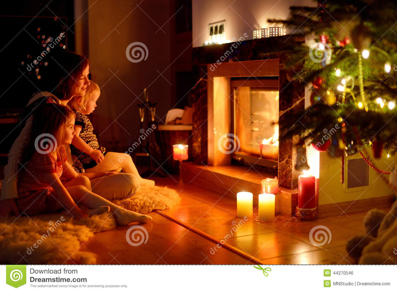 Fall Cabin Wallpaper Happy Family By A Fireplace On Christmas Stock Photo