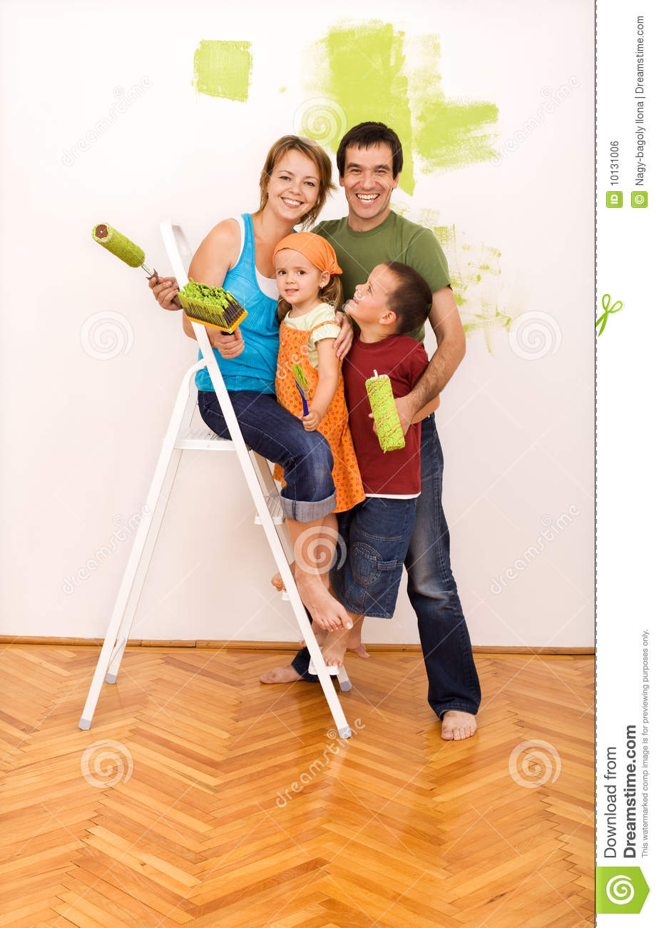 Happy Family Painting Their New Home Together Royalty Free