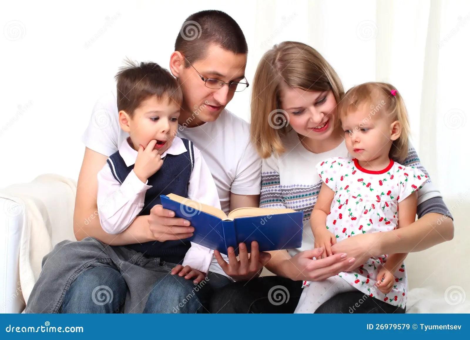 Happy Family Reading In The Kids Room RoyaltyFree Stock