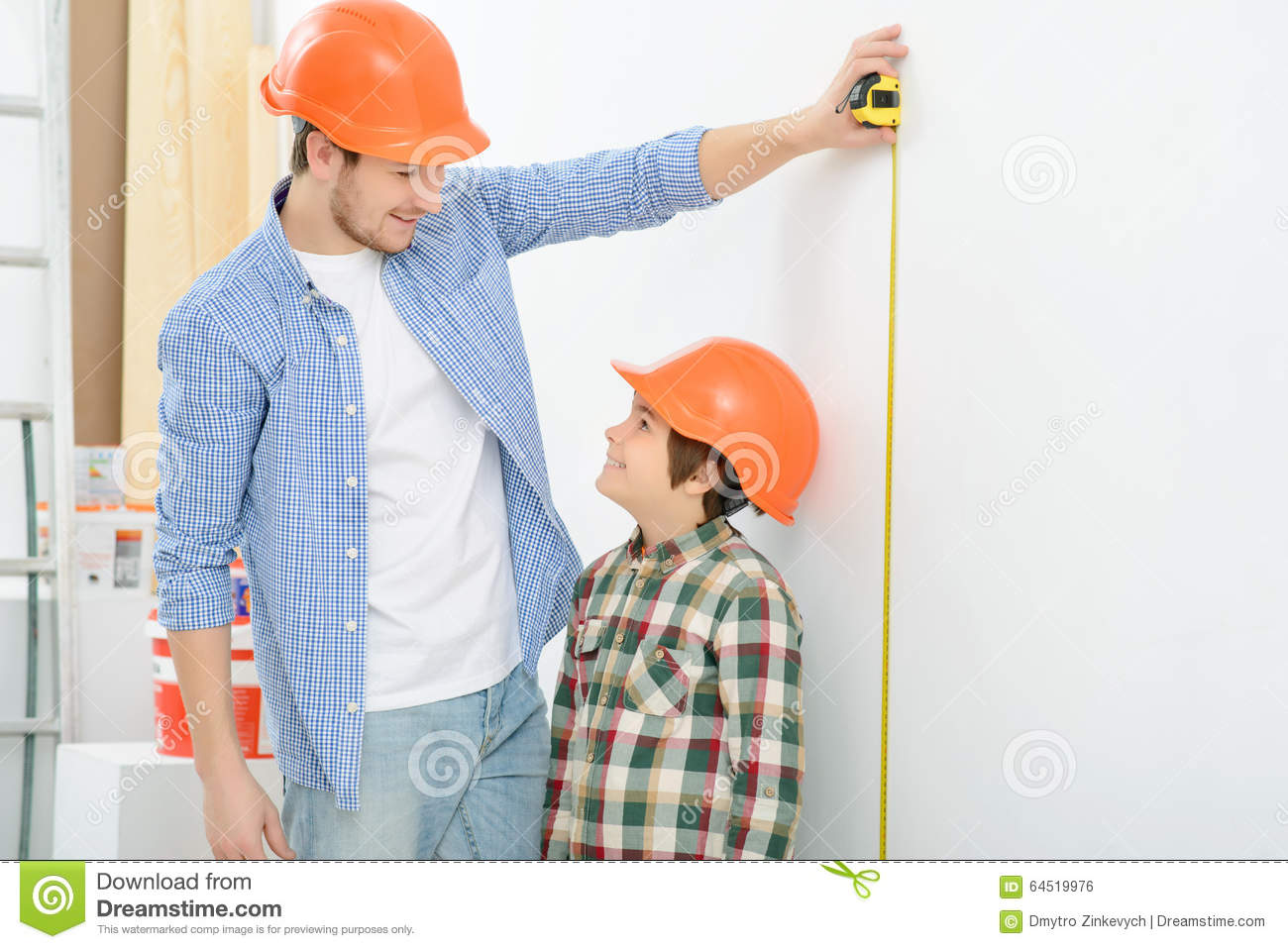 Happy Father And Son Doing Renovation Stock Photo