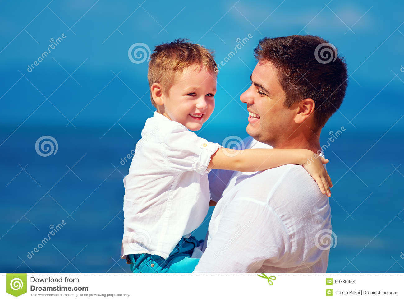 Happy Father And Son Embracing Family Relationship Stock