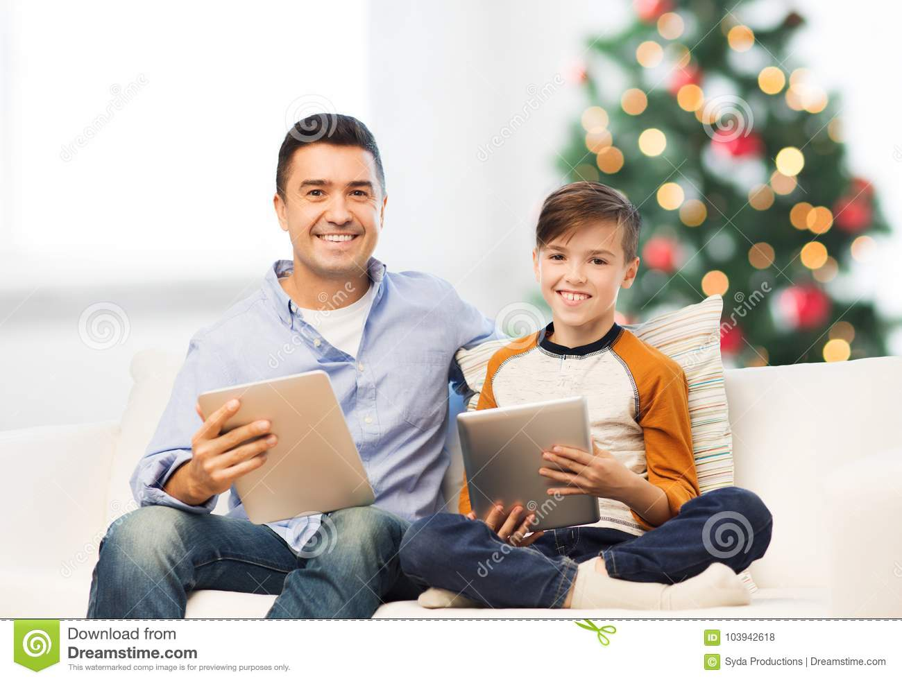 Happy Father And Son With Tablet Pc At Christmas Stock