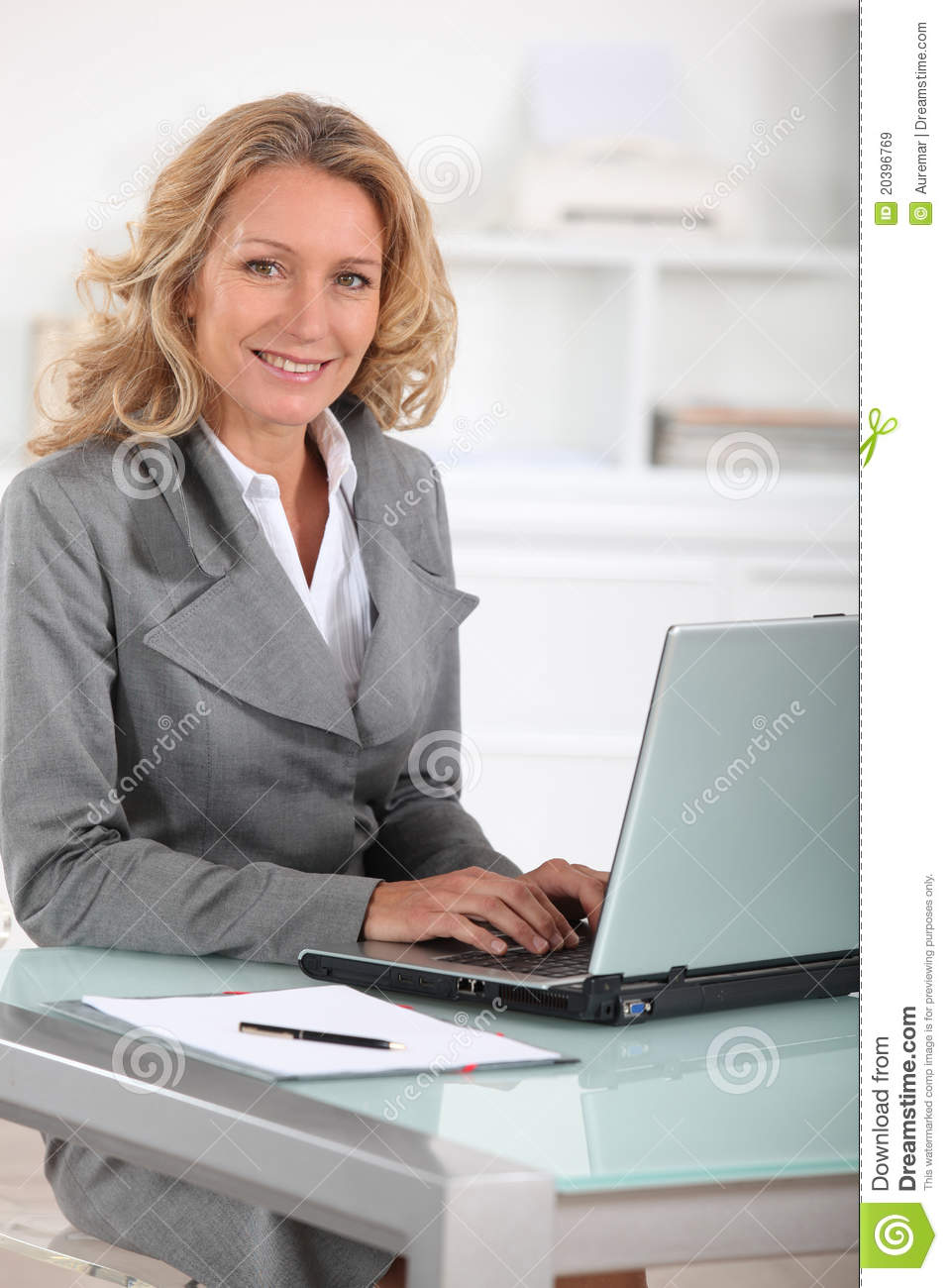 Happy Female Executive At Her Desk Stock Image  Image of