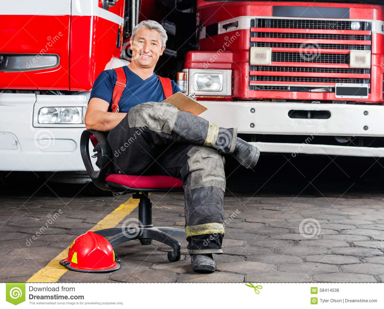 wheelchair on fire high gloss white dining table and chairs happy firefighter sitting chair against trucks stock