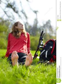 Happy Girl Biker Enjoying Relaxation Sitting Barefoot In