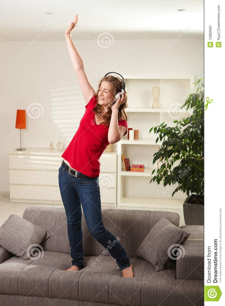 images of living room with red sofa daybed uk happy girl dancing on couch headphones stock image ...