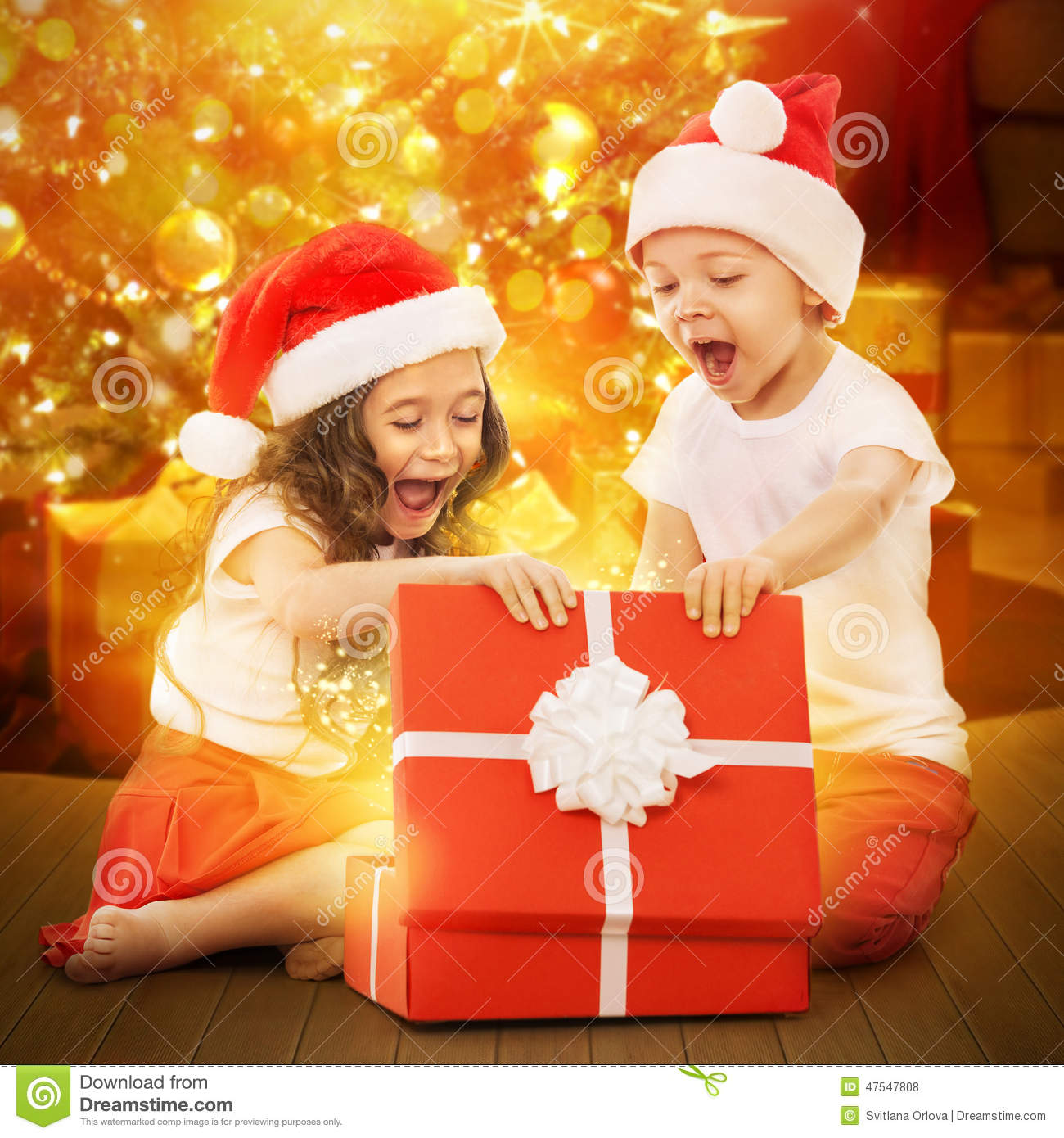 Happy Kids Opening Christmas Presents