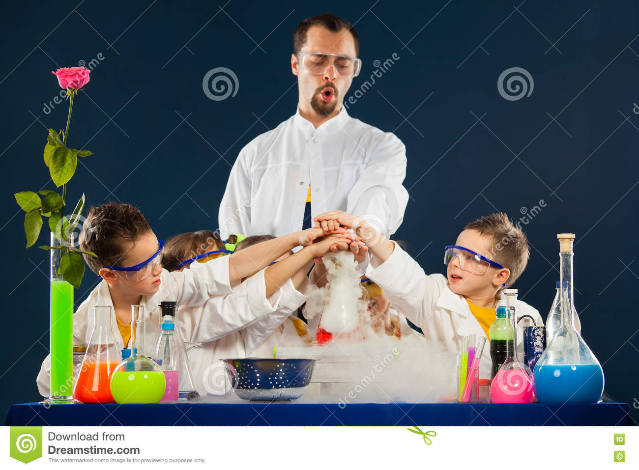 Happy Kids With Scientist Doing Science Experiments In The