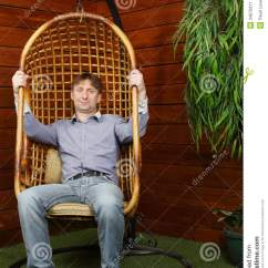Hanging Chair Wicker Swivel Reclining Happy Man Sits In Stock Image - Image: 34670311