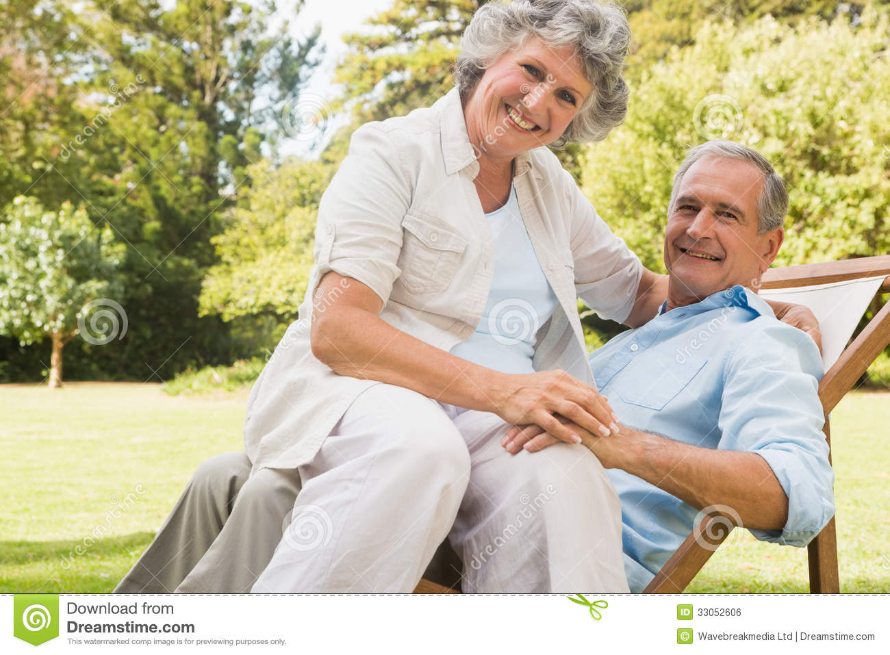 Husband Chair Happy Mature Woman Sitting On Her Husband On Deck Chair