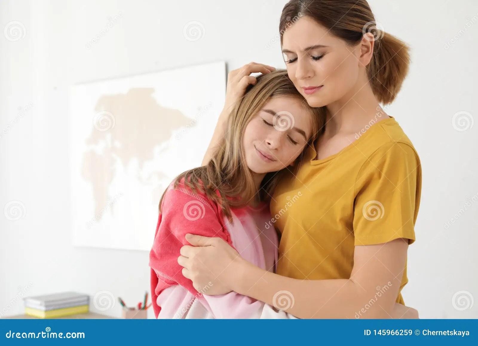 Happy Mother Hugging Her Teenager Daughter Stock Image
