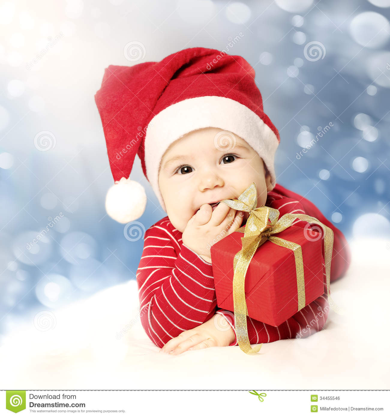 Happy New Year Baby With Red Gift On Snow Royalty Free