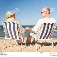 Folding Chair Travel Portable Wheel Happy Senior Couple In Chairs On Summer Beach Stock Photo - Image: 66200254