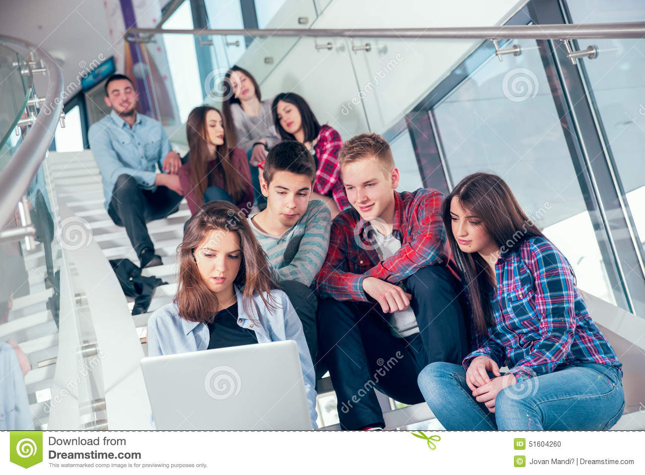 Happy Teen Girls And Boys On The Stairs School Or College