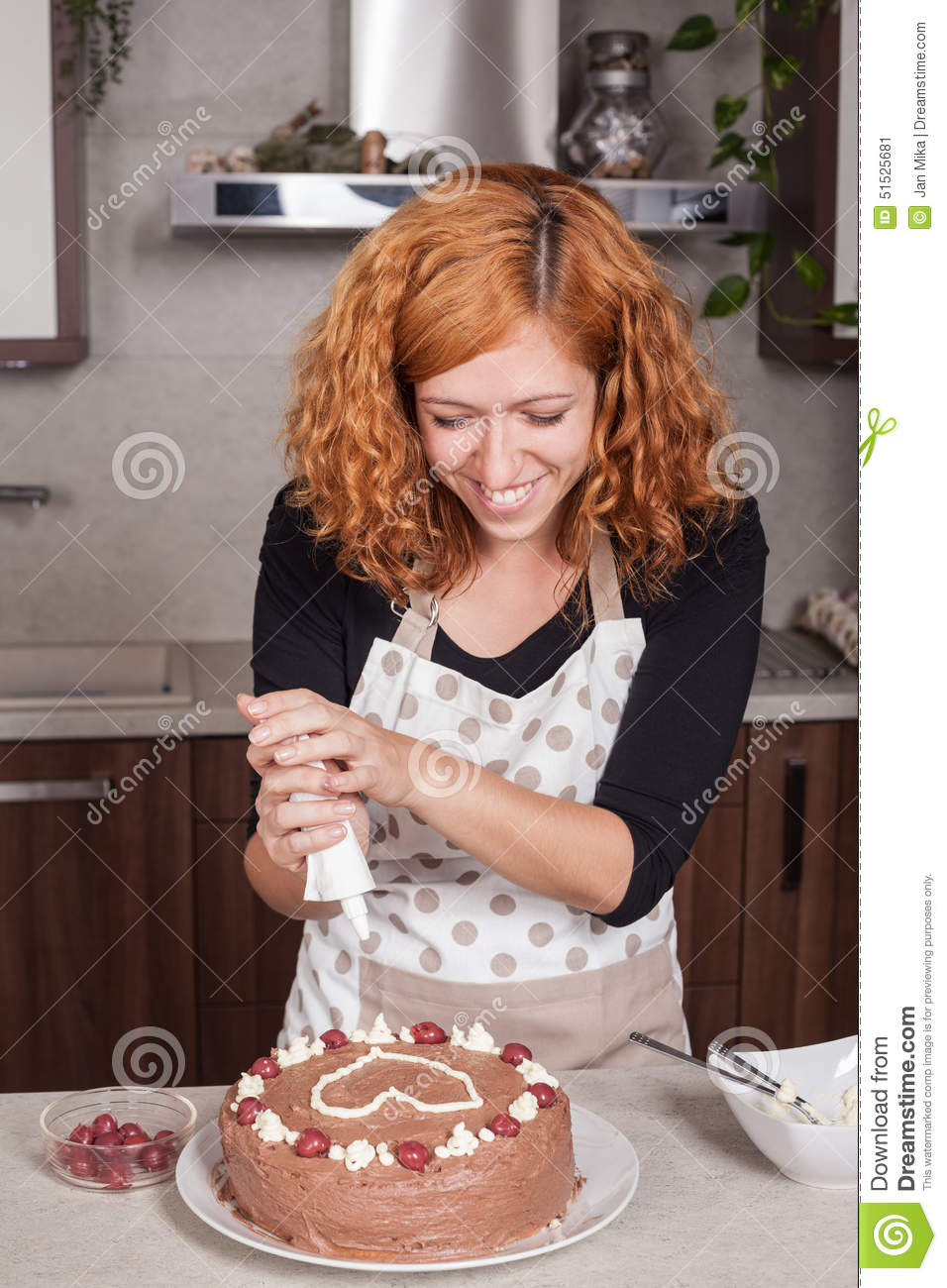 6 person kitchen table grease cleaner happy woman decorating cake at home stock photo - image ...