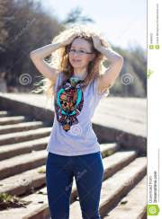 happy woman with glasses and curly