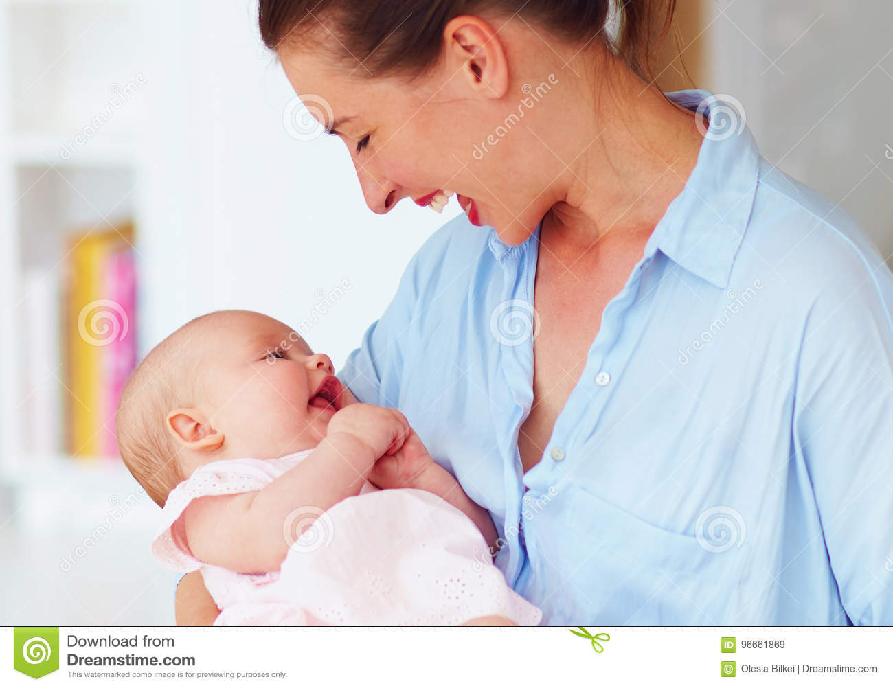 Happy Young Mother Enjoying Communication With Little
