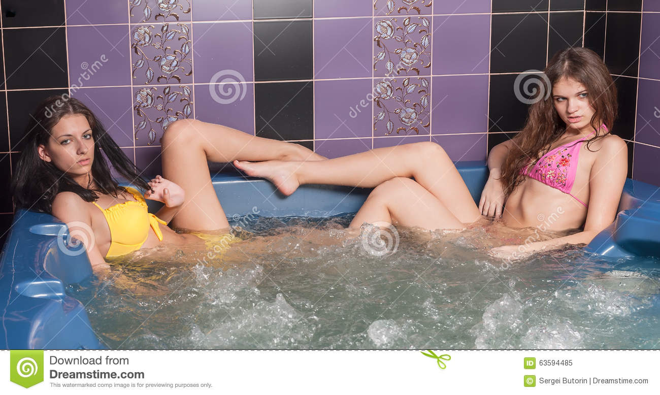 Happy Young Women In Jacuzzi Having Good Time Stock Image