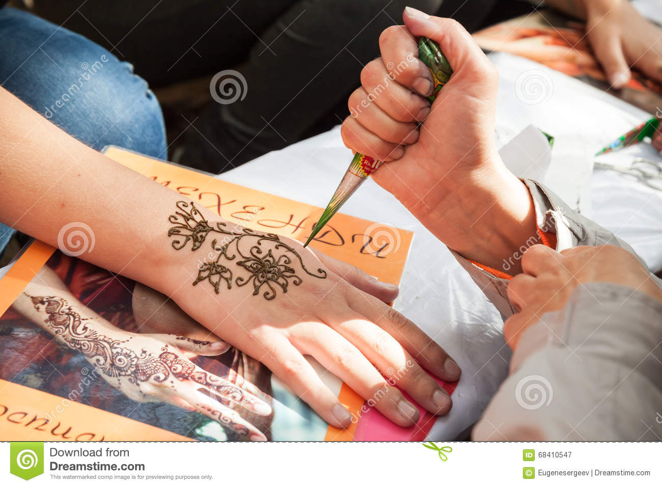 Henna Paste Or Mehndi Application On Female Hand Editorial ...