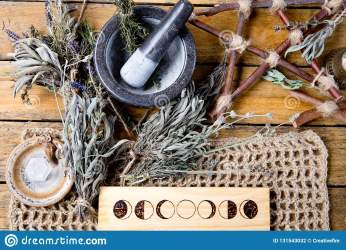 Herbal Witch Mortar And Pestle With Moon Phases Branch Pentagram And Dried Herb Bundles On Rustic Background Stock Photo Image of altar pentagram: 131543032