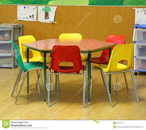 Hexagonal Table With Small Chairs In Elementary School