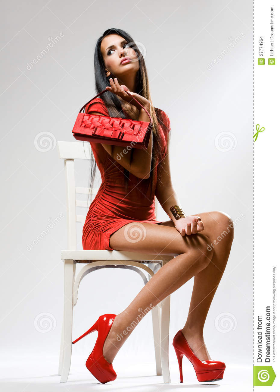 woman sitting in chair small accent chairs uk high red fashion. stock images - image: 27774964