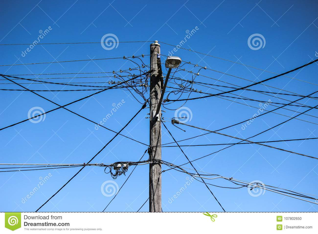 hight resolution of high voltage electricity pole with complex wiring street lamp and blue sky