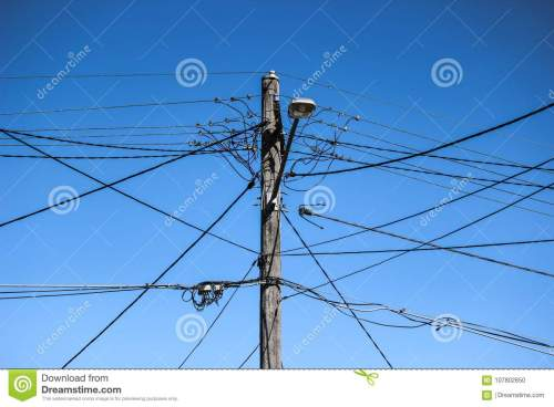 small resolution of high voltage electricity pole with complex wiring street lamp and blue sky