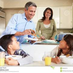 2 Person Kitchen Table Soapstone Counters Hispanic Family Eating Breakfast At Home Together Stock ...