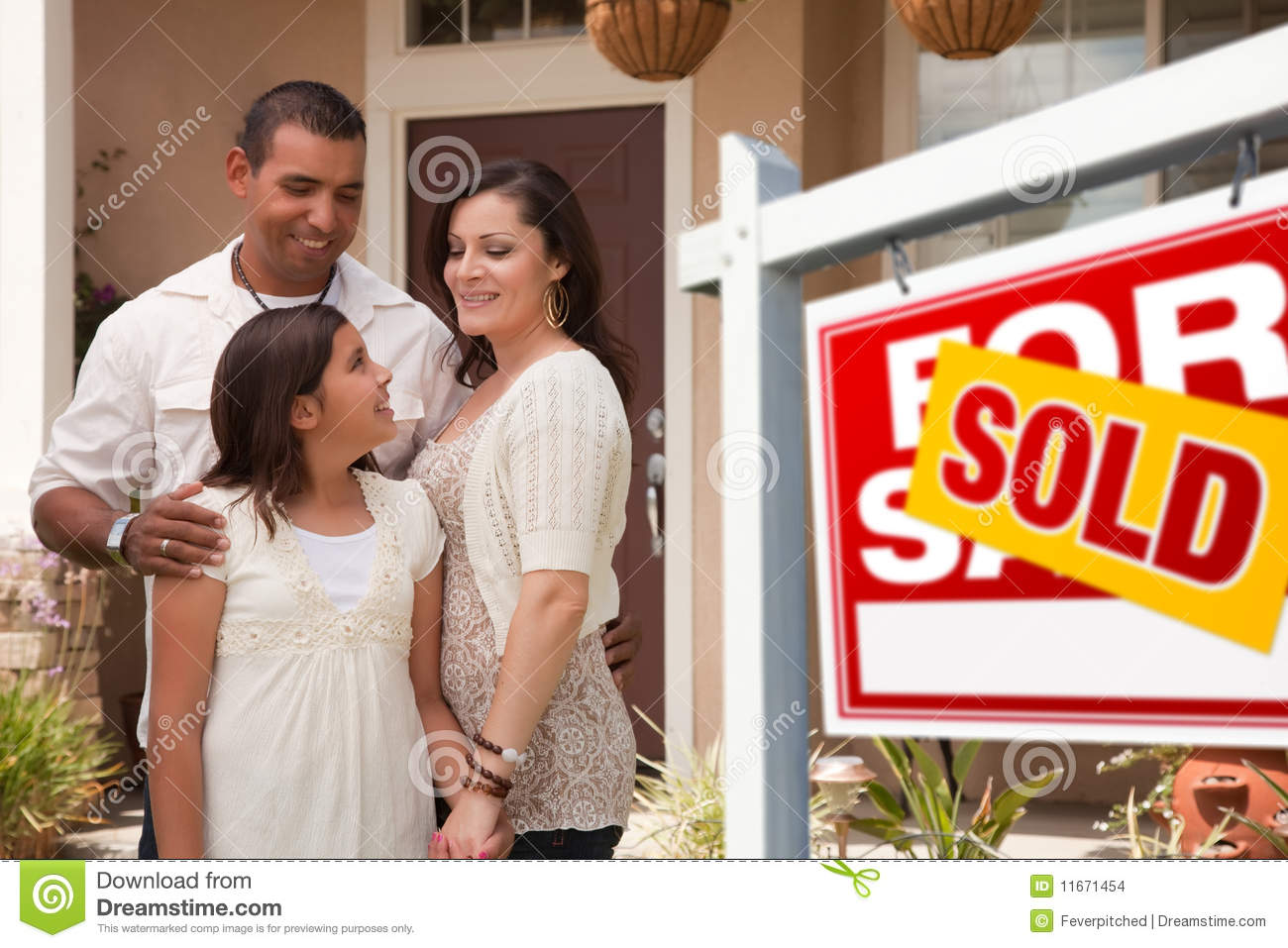 Hispanic Family In Front Of New Home And Sold Sign Stock