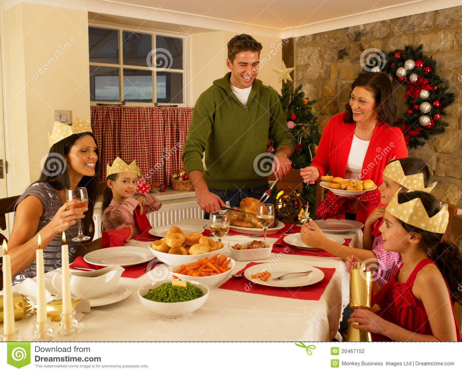 Hispanic Family Serving Christmas Dinner Stock Photography