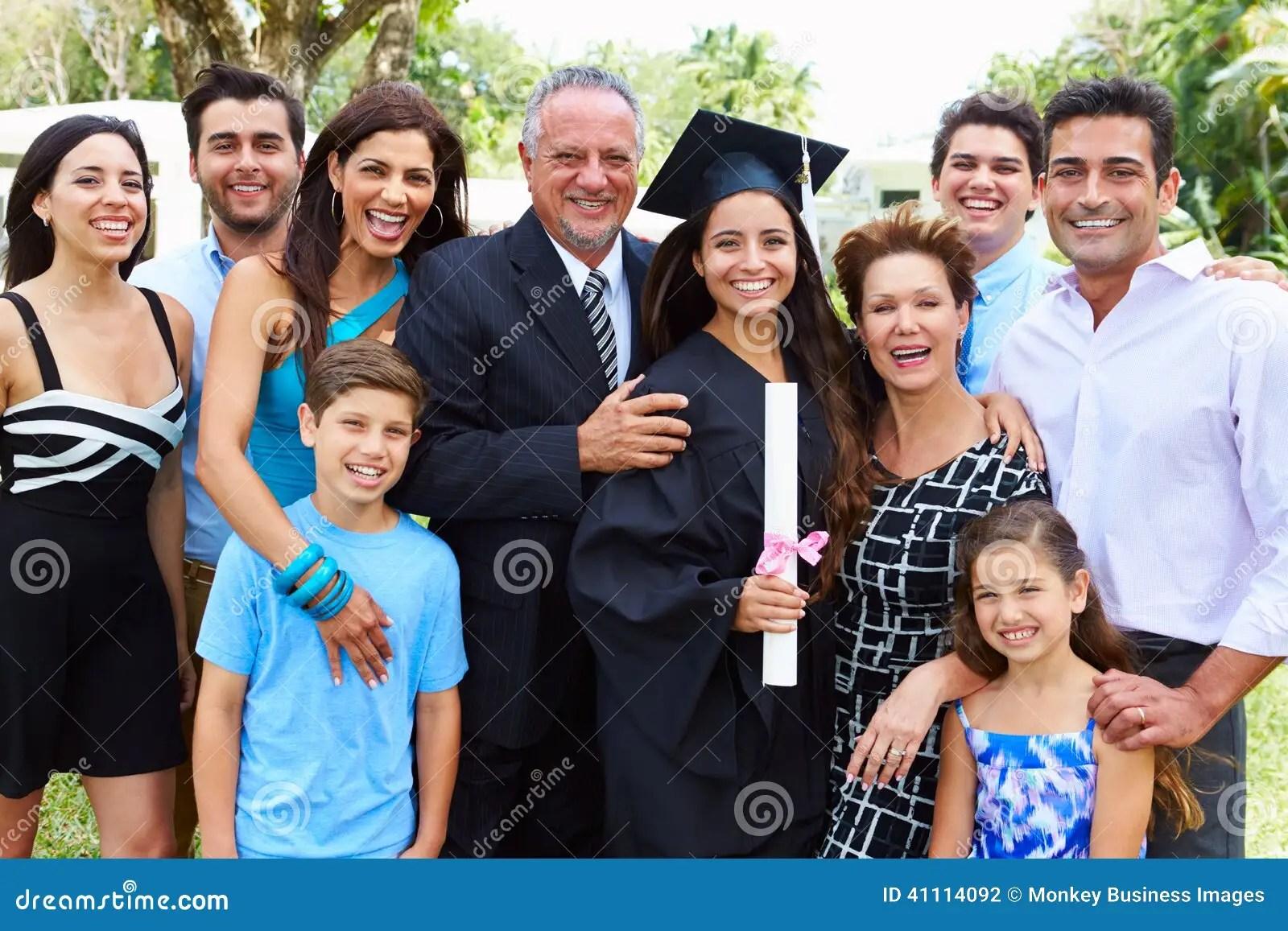 Hispanic Student And Family Celebrating Graduation Stock