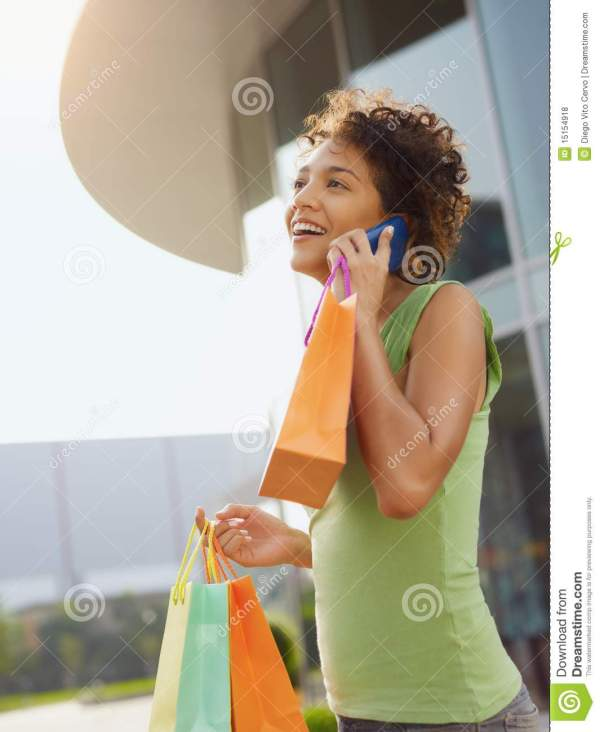 Hispanic Woman With Shopping Bags Royalty Free Stock