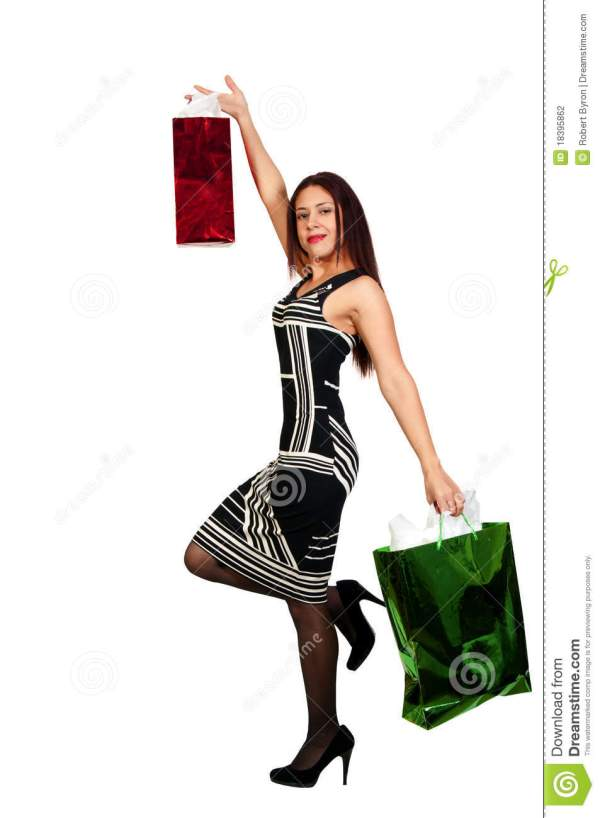 Hispanic Woman With Shopping Bags Stock