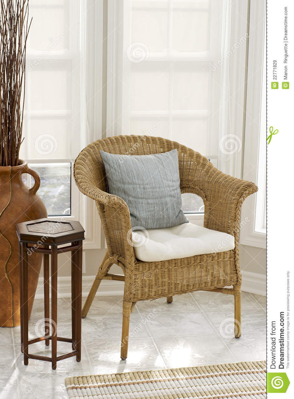 bamboo chairs shelby williams home decor - wicker chair in sun room stock image image: 22771829
