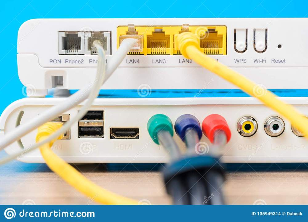 medium resolution of home wireless router with ethernet cables plugged in on blue background close up