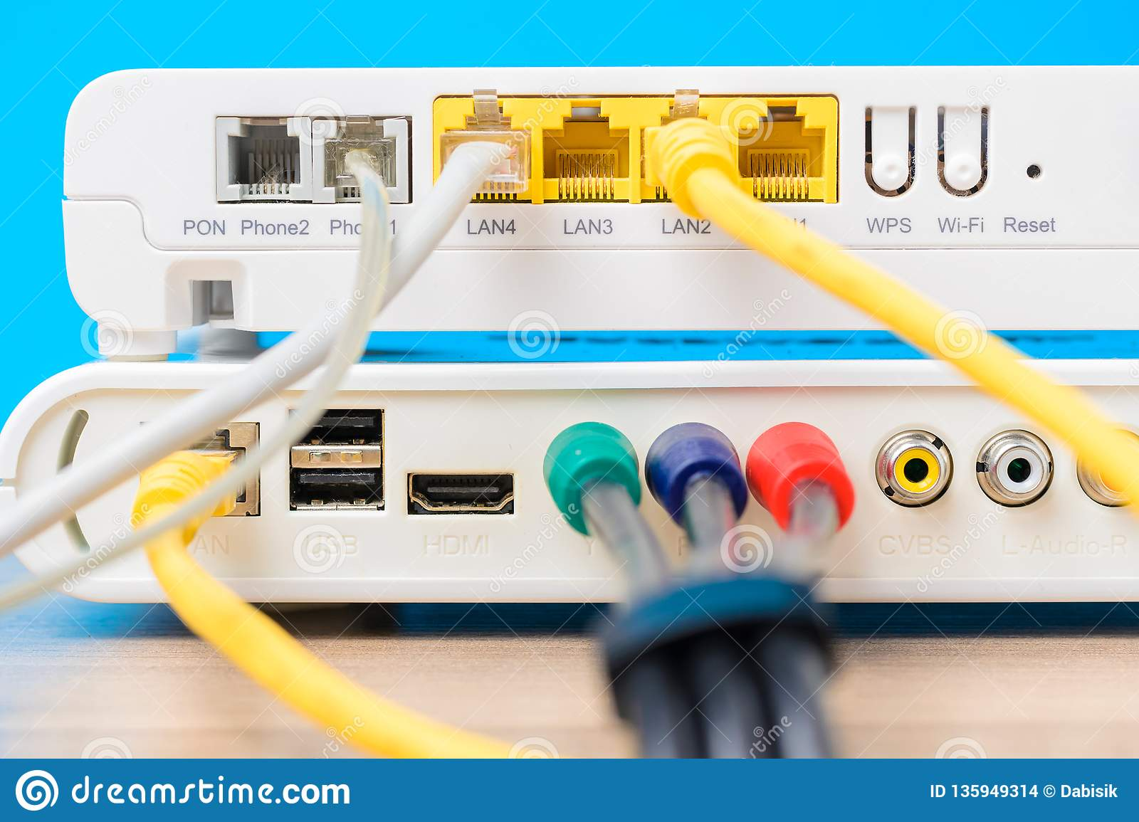 hight resolution of home wireless router with ethernet cables plugged in on blue background close up