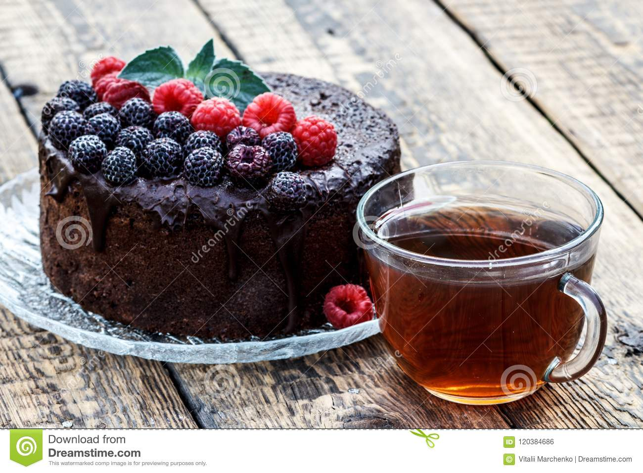 Homemade Chocolate Cake Decorated With Black And Red Raspberries