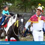 Horseriders In Funny Dress During Village Celebration Ecuador Editorial Photography Image Of Sport Children 190282537