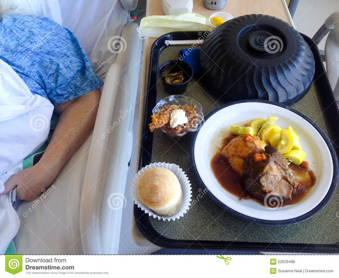 Hospital Food On A Tray With Patient S Arm Visible Stock