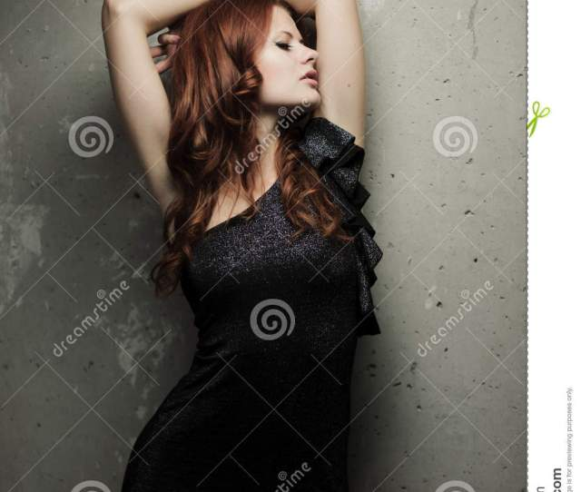 Fashion Sensual Portrait Of Young Redhead Girl Over Grunge Wall