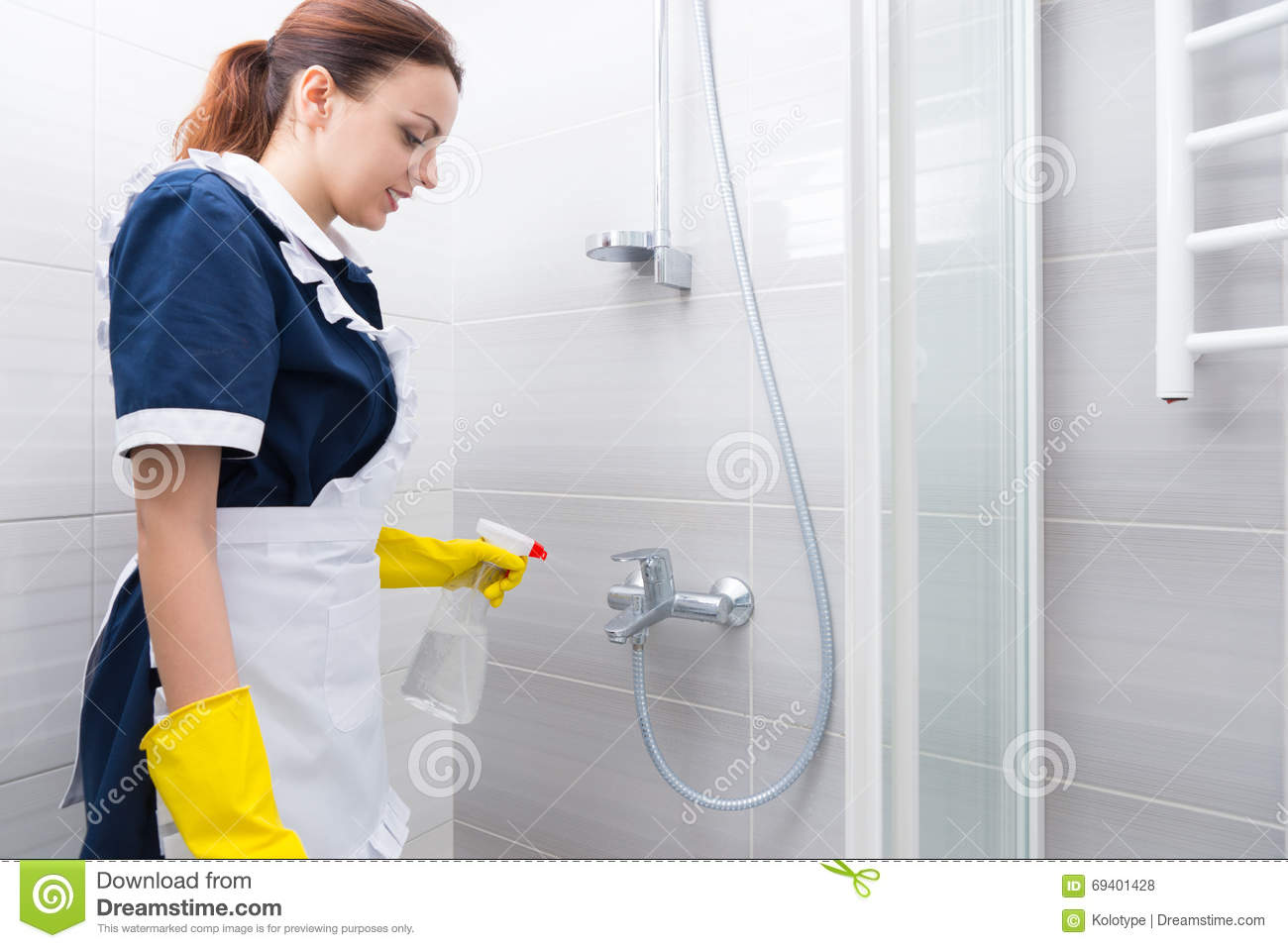Hotel Housekeeper Cleaning A Bathroom Stock Photo Image