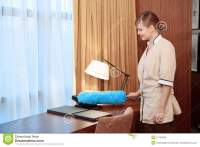 Hotel Maid Dusting Furniture Stock Photo - Image: 51745695