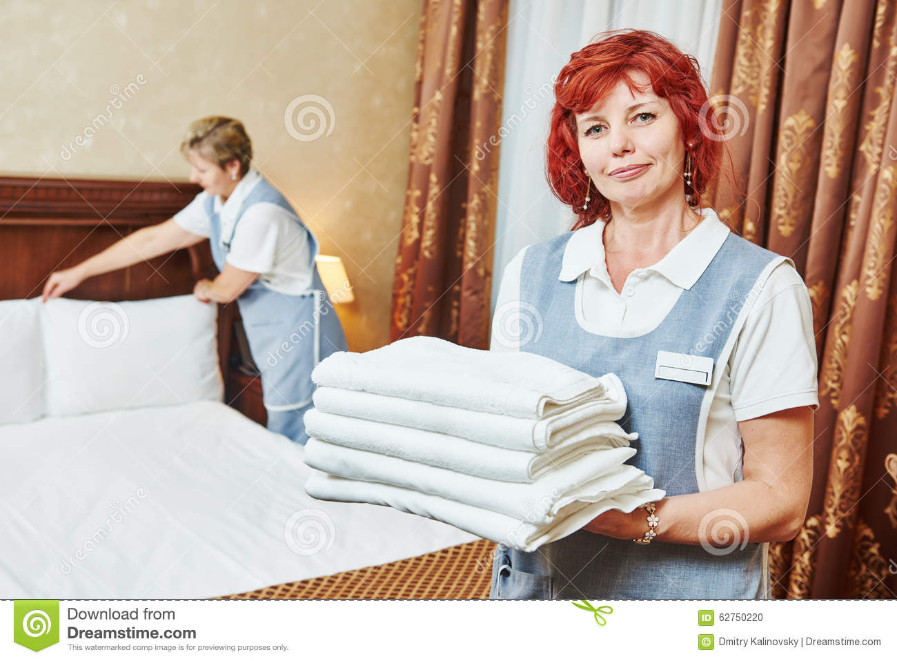 Maid At Work And Cleaning In Luxury Hotel Room Royalty